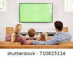 rear view of family sitting on... | Shutterstock . vector #710825116