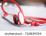 stethoscope isolated on white | Shutterstock . vector #710839354