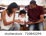 parents sitting and reading... | Shutterstock . vector #710842294