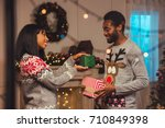 smiling african american couple ... | Shutterstock . vector #710849398