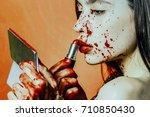 halloween girl applying red...   Shutterstock . vector #710850430