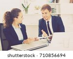 young man and woman coworkers... | Shutterstock . vector #710856694
