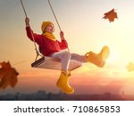happy child girl on swing in... | Shutterstock . vector #710865853
