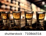 four shots of whiskey alcohol... | Shutterstock . vector #710866516