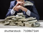 man holding money in hand at... | Shutterstock . vector #710867164