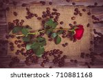 Red Rose And Coffee Beans On A...
