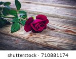 A Beautiful Red Rose On An Old...