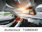 woman drive a car reflects in... | Shutterstock . vector #710883640