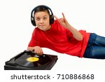 Young caucasian teenage boy listening to music - stock photo