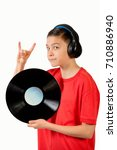 Young caucasian teenage boy holding a vinyl lp - stock photo