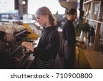side view of young baristas... | Shutterstock . vector #710900800