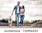 romantic couple is on a walk in ... | Shutterstock . vector #710906353