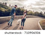 Stock photo romantic couple is on a walk in the city with their dog labrador beautiful young woman and 710906506