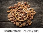 different types of nuts.... | Shutterstock . vector #710919484