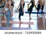 group young woman doing yoga... | Shutterstock . vector #710950084