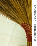 Small photo of Old straw broomstick ready sweep isolated on white background