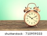 old fashion alarm clock on... | Shutterstock . vector #710959333