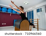 young fit woman stretching on a ... | Shutterstock . vector #710966560