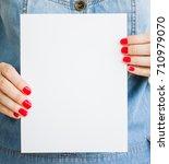 woman  girl holds blank white... | Shutterstock . vector #710979070