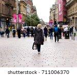 woman walking down... | Shutterstock . vector #711006370