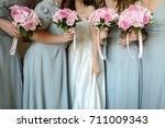 Bride With Flowers And Maids O...