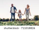 happy family outdoors spending... | Shutterstock . vector #711018826