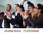 business team applauding ... | Shutterstock . vector #711023068