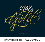 stay gold. hand drawn... | Shutterstock .eps vector #711039580