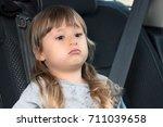a beautiful little girl is...