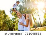 mother and father play with the ... | Shutterstock . vector #711045586