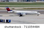 Small photo of SALT LAKE CITY, UTAH – April 16, 2016: A Bombardier CRJ-700 of SkyWest Airlines, operating as Delta Connection, taxies to the runway for departure at Salt Lake City International Airport.