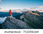 a girl is enjoying a wonderful... | Shutterstock . vector #711056164