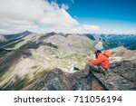 a girl is taking some rest... | Shutterstock . vector #711056194