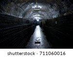 warehouse bottles of champagne. | Shutterstock . vector #711060016