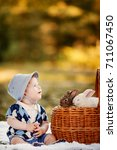 Small photo of Little boy playing with rabbits in the park, summer and autumn landscape. Concept first childhood acquaintance, friends with animals. copyspace