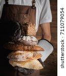 variety of freshly baked breads ...   Shutterstock . vector #711079054