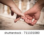 hands of two lovers intertwined | Shutterstock . vector #711101080