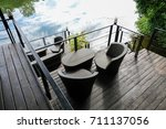 lounge chair on the balcony | Shutterstock . vector #711137056