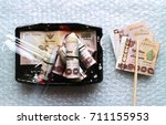 rolls of money on japanese... | Shutterstock . vector #711155953