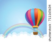 cloudscape with rainbow and hot ... | Shutterstock .eps vector #711165634