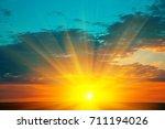 beautiful blazing sunset... | Shutterstock . vector #711194026