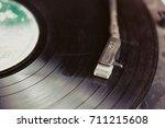 vintahe record player stylus on ... | Shutterstock . vector #711215608