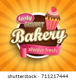 sweet bakery label with cupcake ... | Shutterstock .eps vector #711217444
