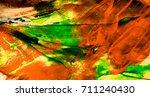 orange yellow green daub with... | Shutterstock . vector #711240430