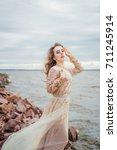 young beautiful caucasian woman ... | Shutterstock . vector #711245914