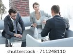 woman lawyer advises his client | Shutterstock . vector #711248110