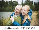happy grandmother and her ... | Shutterstock . vector #711250510