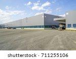 a modern factory building  | Shutterstock . vector #711255106
