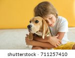 child with dog | Shutterstock . vector #711257410