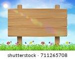 wooden board sign on grass sky...   Shutterstock .eps vector #711265708